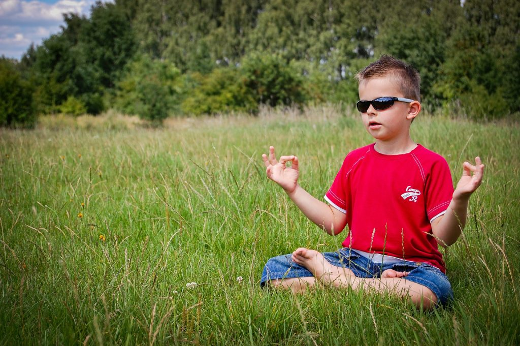 live in the moment - boy meditating
