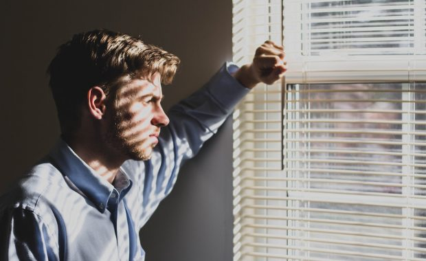 Postnatal depression in men - image of man in window